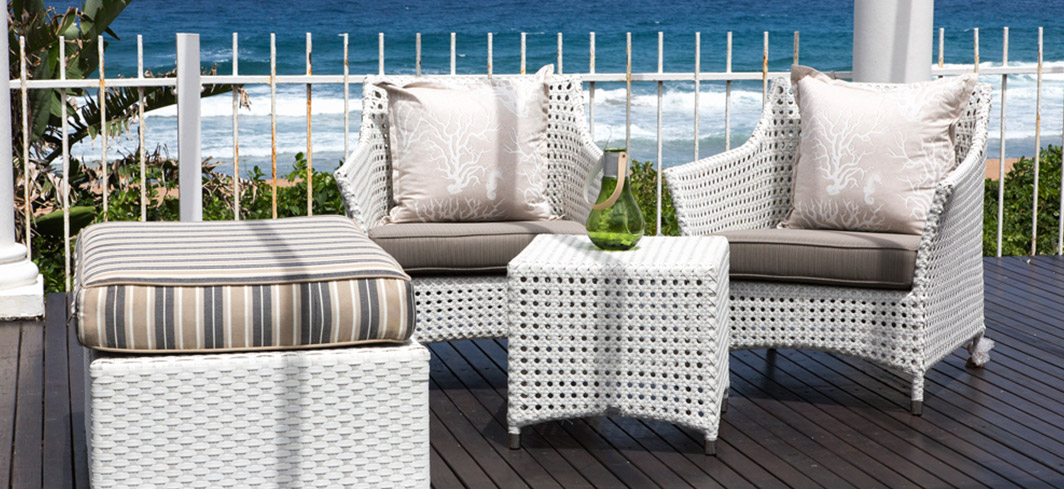 White outdoor armchairs