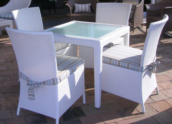 Malindi four seater dinning table with toughened glass inlay.
