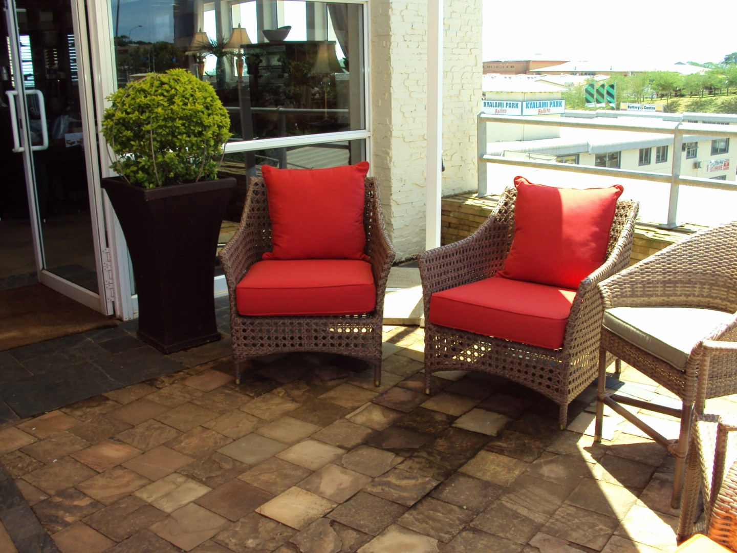 Special weaved Elita arm chairs in coffee cream