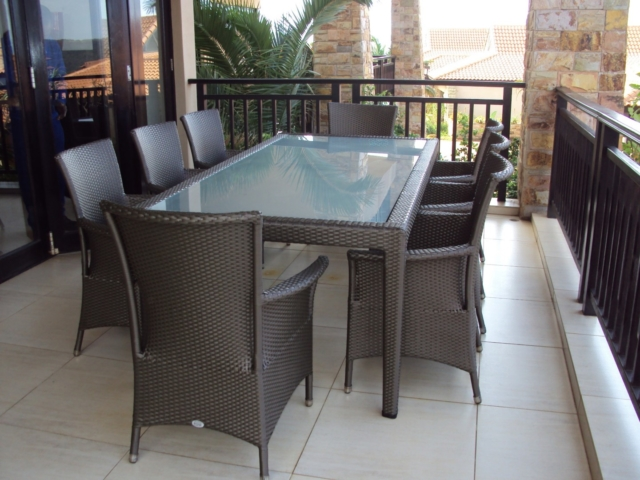 Malindi 6 - 8 seater dinning table with toughened glass inlay