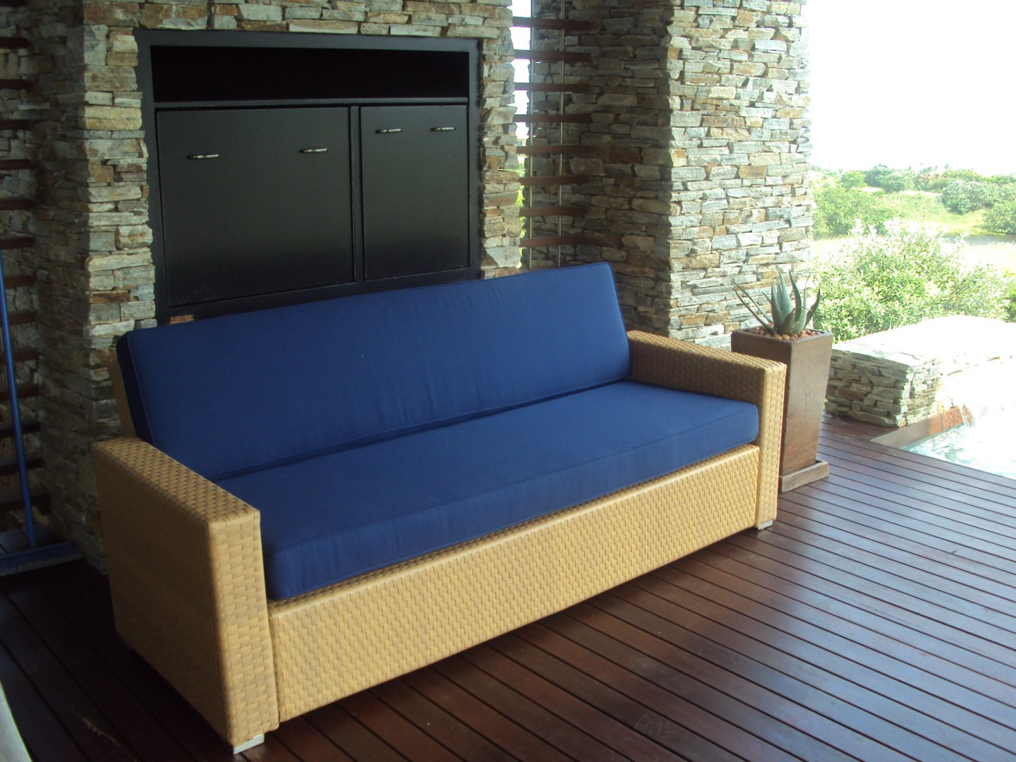 Four seater sofa with blue cushions