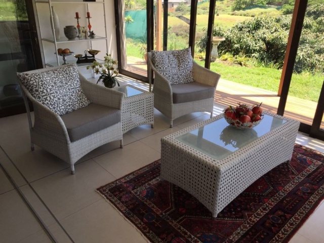 Single weaved armchairs in white