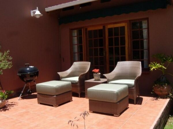 Two Makuti armchairs and three ottomans.