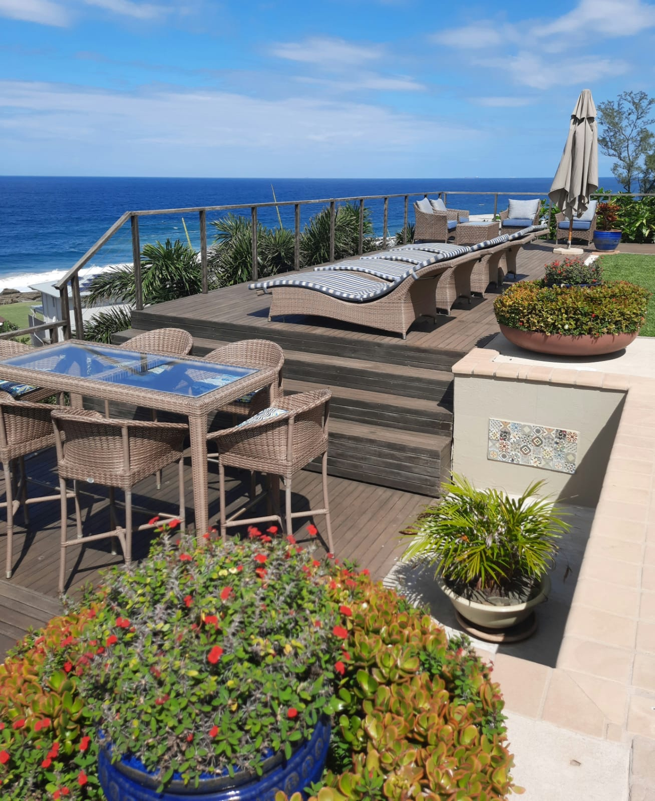 Mirage outdoor loungers and bar table and bar stools